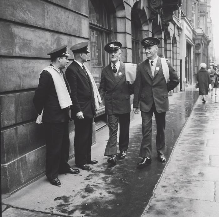Invisible Men displays clothing like thesepostmen's uniforms from 1960