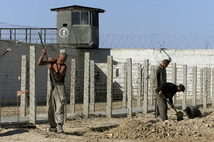 Uzbek convicts toil in the yard of Uzbekistan's dreaded Jaslik jail, which is 1,000 kms west from the capital Tashkent