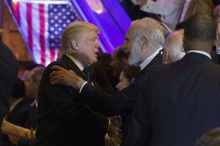 Donald Trump withCarl Icahn, who was so sure that Mr Trump's election victory would be a boon to the economy that he placed a $1bn bet that the stock market would recover from the fright