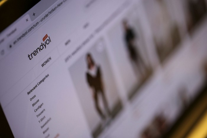 A laptop screen displays Trendyol online shopping site