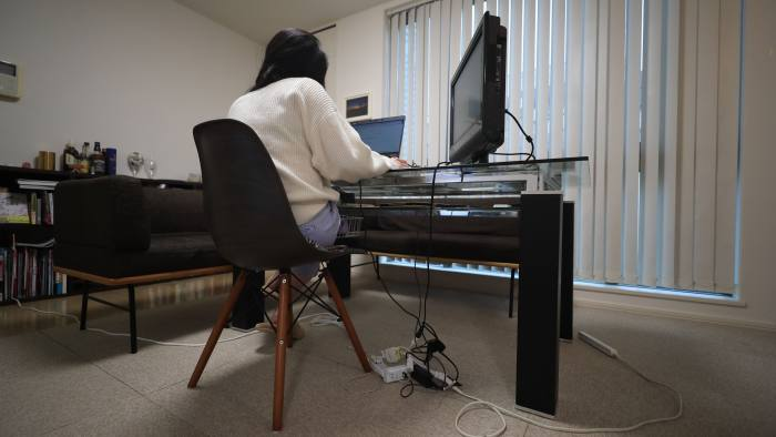 A woman works from her home in Tokyo during the pandemic