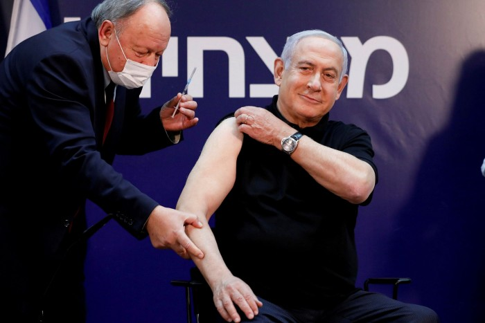Benjamin Netanyahu receives a Covid jab. Faced with a dogged core of vaccine scepticism, the Israeli prime minister has pleaded with some 570,000 unvaccinated people over 50 to come forward
