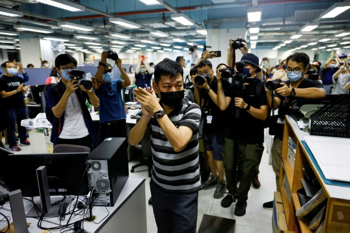 Lam Man-chung, former executive editor-in-chief of Apple Daily,  marks the newspaper's final edition in Hong Kong last month