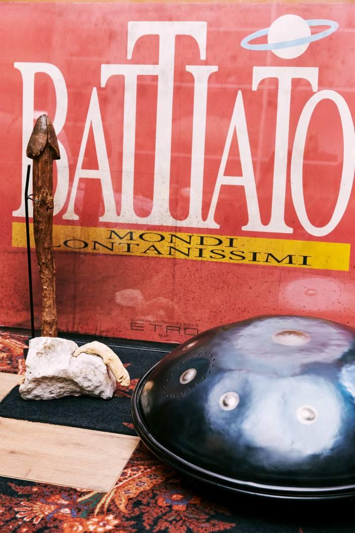 Etro's holed stone,Franco Battiato record andhand drum