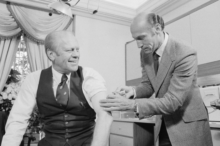 Former US president Gerald Ford receives a swine flu shot in 1976