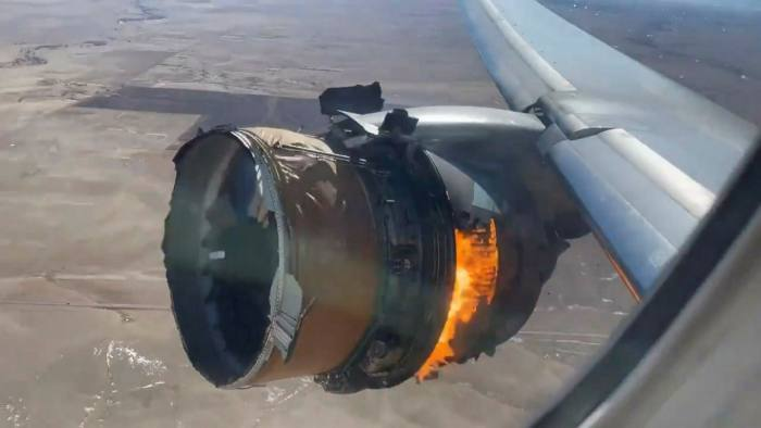 "In this image taken from video, the engine of United Airlines Flight 328 is on fire after after experiencing ""a right-engine failure"" shortly after takeoff"
