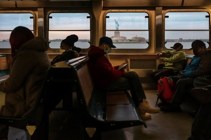 Passengers on the Staten Island ferry, April