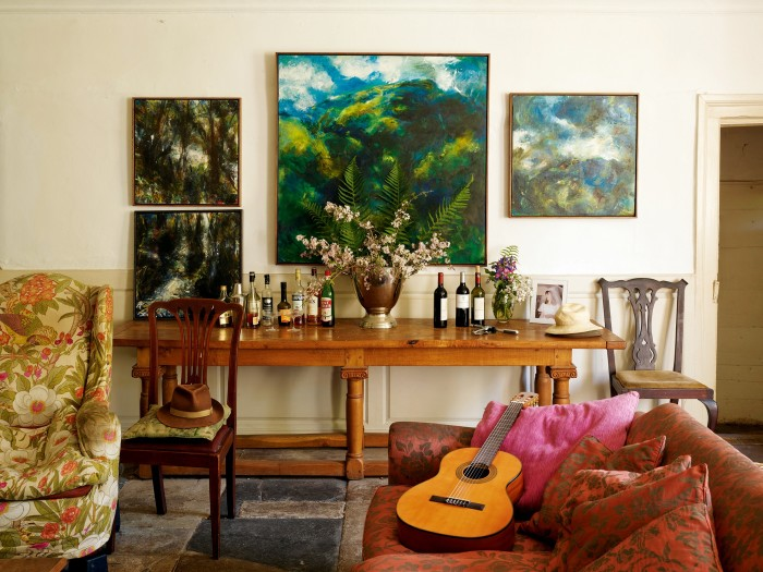 Oils by Yasmin David in the sitting room. From left: Untitled (Woodland Stream Diptych), c2003; Untitled (Large Green Landscape), c1996; Untitled (Molten Landscape), c2003