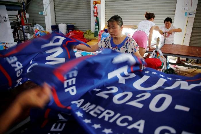 Workers make flags for Trump's 'Keep America Great!' 2020 re-election campaign at a factory in Fuyang, Anhui province, China