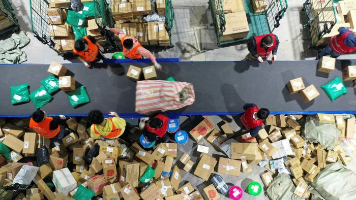Warehouse employees work in Hengyang, Hunan province. A declining working population requires that the pace of the declinein productivity drops by nearly two-thirds if China is to double GDP by 2035