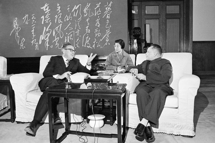 Chinese Premier Deng Xiaoping  listens to US secretary of state Henry Kissinger during their meeting in Beijing in 1974
