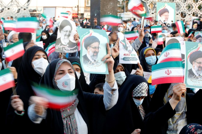 Supporters of Iranian president elect Ebrahim Raisi celebrate in Tehran last month: he wants to extend the 'hand of friendship and brotherhood'