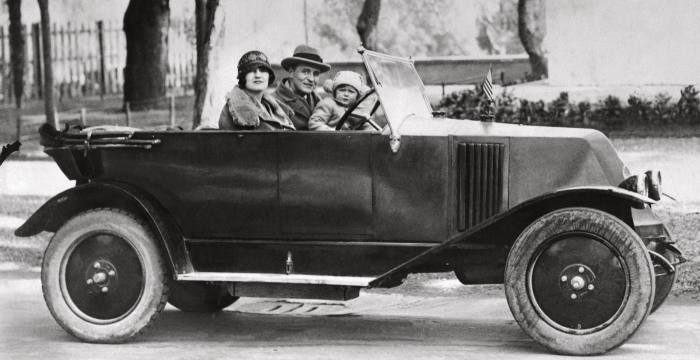 F Scott Fitzgerald at the wheel in Italy with his wife Zelda and daughter Scottie
