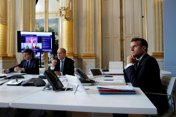 French president Emmanuel Macron takes part in a video conference on vaccination. France sparked furious protests when it seized millions of masks belonging to a Swedish healthcare company