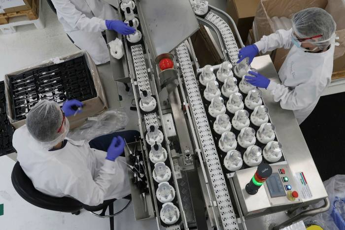 Workers at the Christian Dior factory make hand sanitisers for hospitals in Paris last March