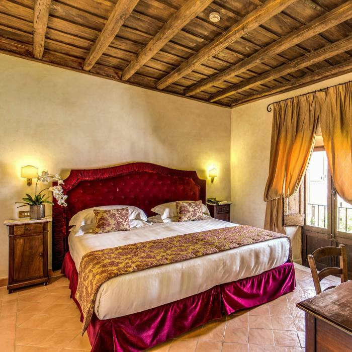 Many rooms in Donna Camilla Savelli – a former 17th-century convent – have original beams in the ceiling