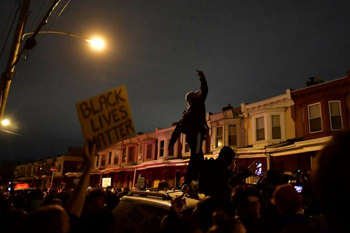 Demonstrators gather in Philadelphia to protest against the recent killing of a black man by police officers. Donald Trump has attempted to win over Republican women by arguing that suburbs are threatened by such protests