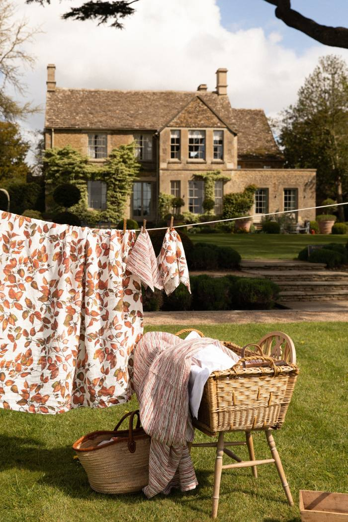 Bertioli by Thyme Copper Beech tablecloth (on washing line), and Red Stem tablecloth (in basket), both £260. Napkins, £25 each