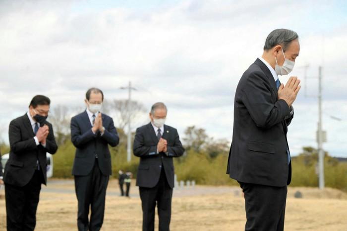 Prime Minister Yoshihide Suga at a memorial dedicated to victims of the earthquake and tsunami in Namie, Fukushima