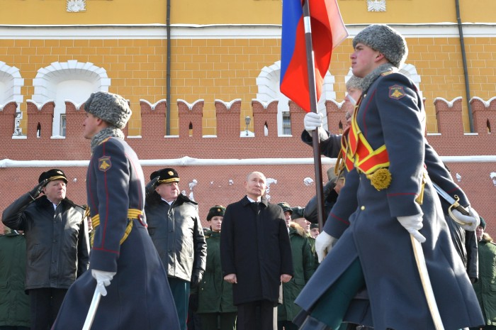Strongman tactics: Putin attends a ceremony in Moscow to mark Defender of the Fatherland Day in February