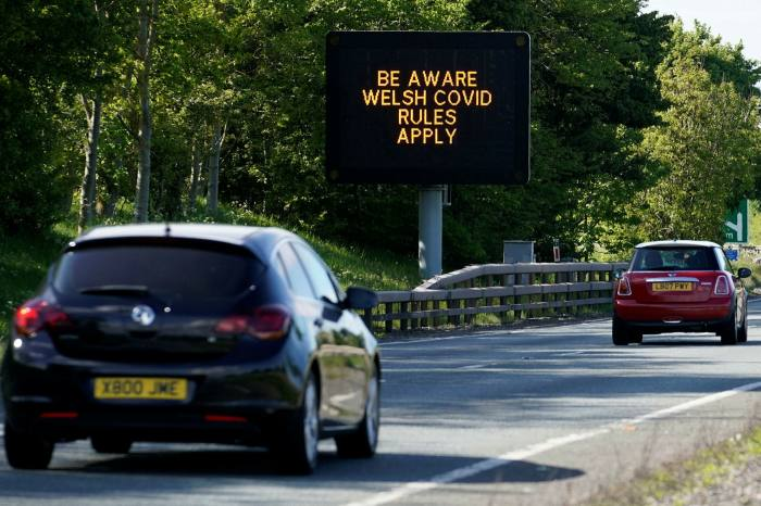 A sign advises motorists that lockdown rules in Wales are different to England