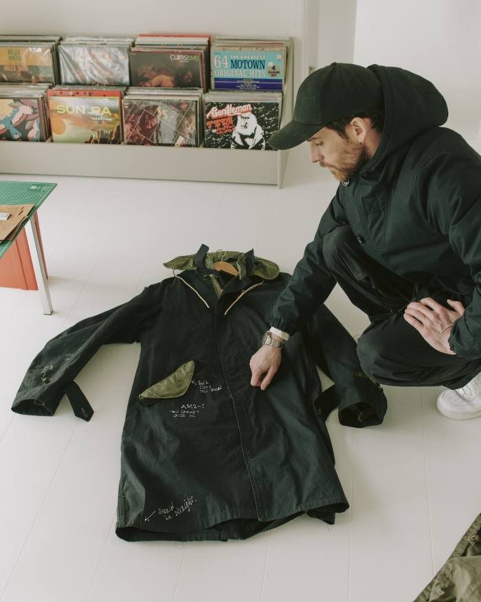 Berryman with theprototype for the Applied Art Forms AM2-1 modular parka. He wears its CM1-1 hooded deckjacket, €790