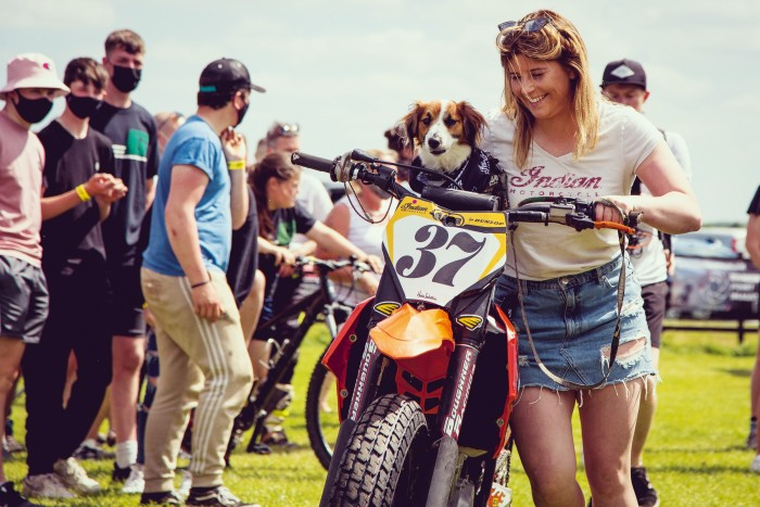 Leah Tokelove and dog Dingo with her pro-class KTM 450
