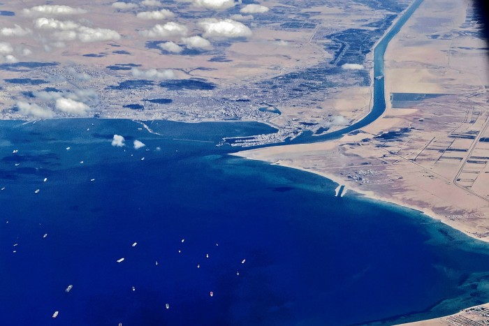 Ships wait to enter the Suez Canal last month after it was blocked by the Ever Given