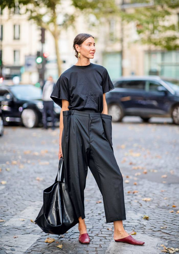 Vogue Ukraine fashion director Julie Pelipas in oversized trousers at Paris Fashion Week 2018