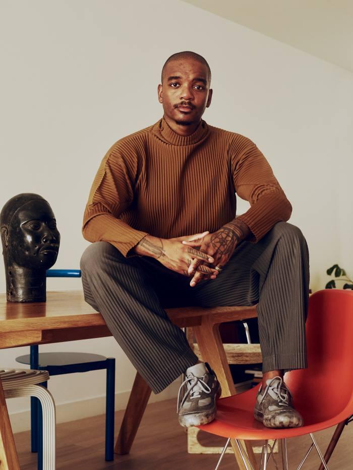 Fashion designer Samuel Ross wears Homme Plissé at home inLondon