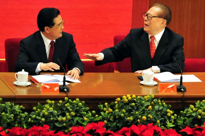 Then president Hu Jintao (L)  chats with his predecessor Jiang Zemin (R) as top Communist party leaders attend an event marking the 30th anniversary of economic reforms at the Great Hall of the People in Beijing in 2008