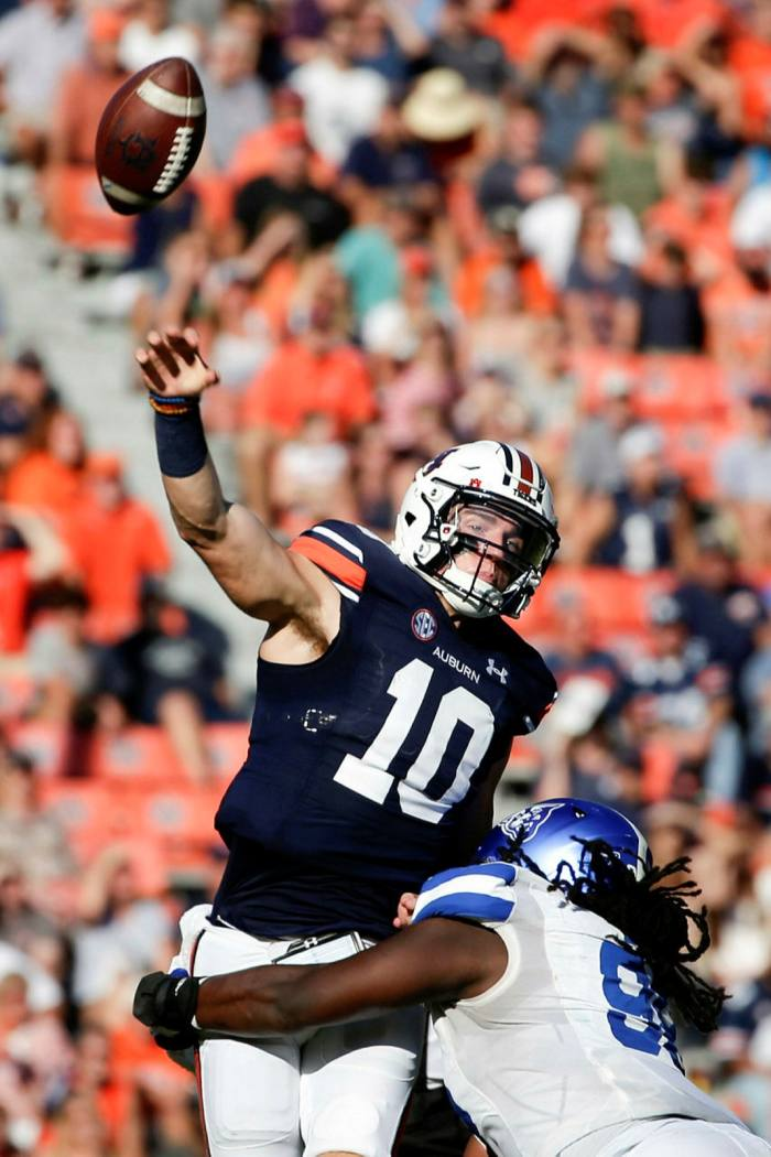 Auburn quarterback Bo Nix (10) is hit as he throws a pass by Georgia State defensive end Javon Denis (98) during the first half of an NCAA football game last month