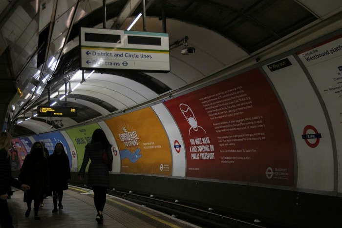 People walk through a Tube station in London. Analysis by Public Health England is believed to show the BioNTech/Pfizer and Oxford/AstraZeneca vaccines are starting to slow transmission