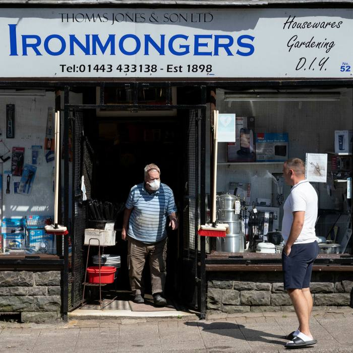 A customer leaves an Ironmongers wearing a face mask in Penygraig, Wales. Close to 6m small businesses employ more than 16m people in the UK, generating £2.2tn in turnover last year