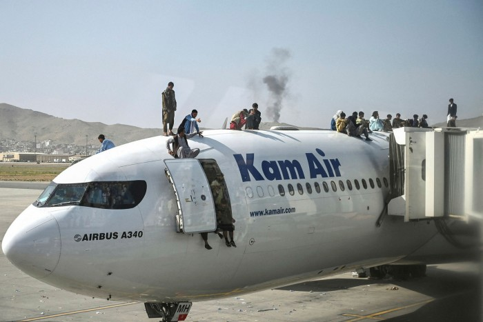 Afghans trying to flee the country climb on top of an aircraft at Kabul airport. Western military chiefs planning the final exit are expected to set false deadlines in the coming days to try to seize the initiative over the Taliban