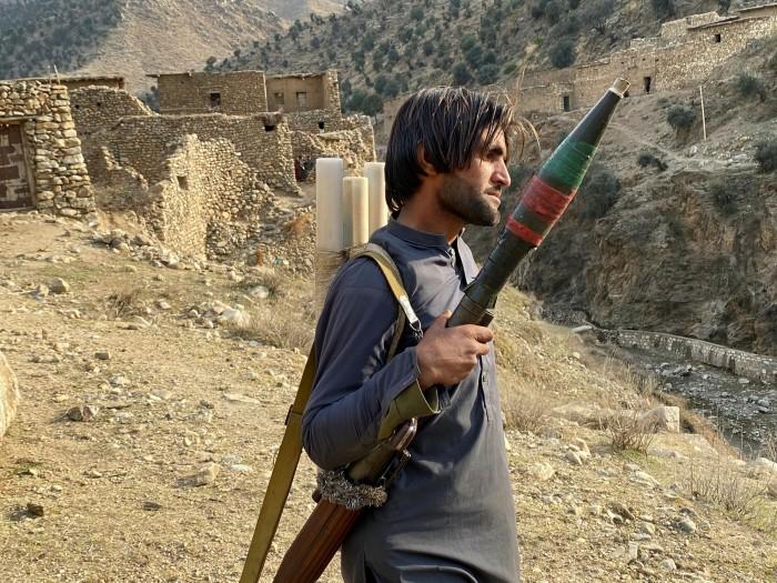 A local militiaman and his RPG launcher near the Pakistan border