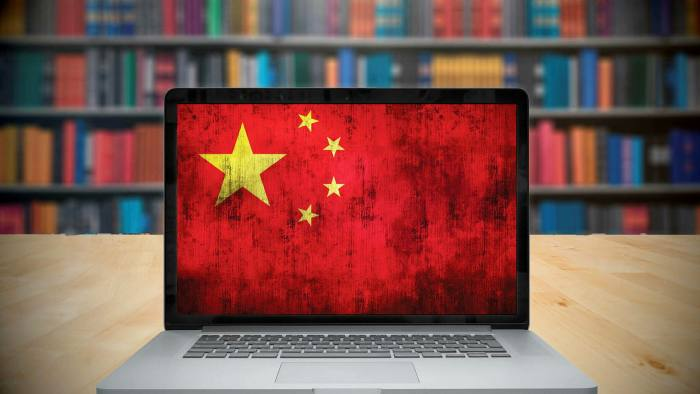 Montage of laptop computer with China's flag on screen