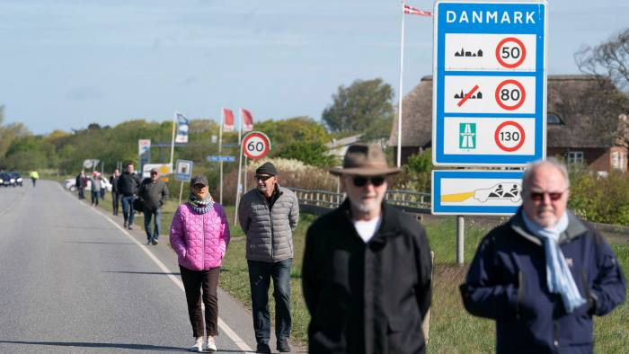 People gather at the border crossing at Saed, Denmark, on Sunday for a demonstration to open the frontier between Denmark and Germany