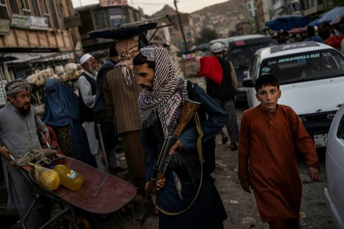 Taliban militants control the Kabul market