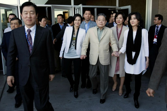 Lee Kun-hee with his daughters in 2012. Many of the legal loopholes that allowed the succession from Lee Kun-hee to his son Lee Jae-yong have been closed