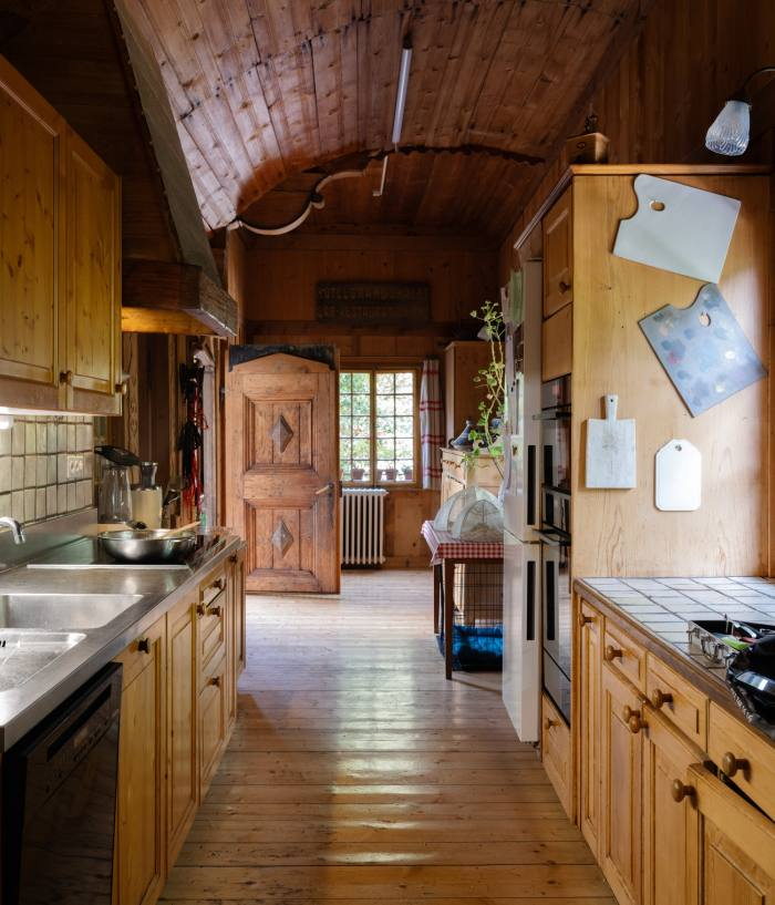 The chalet's kitchen. Harumi's serval cat and labradoodle sleep here at night