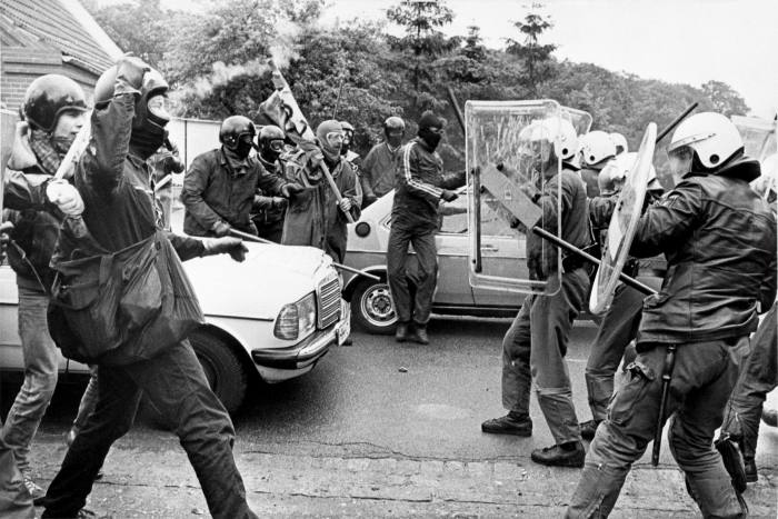Masked demonstrators with sticks confront West German police during anti-nuclear protests in Kleve, near Brokdorf, Germany in 1986