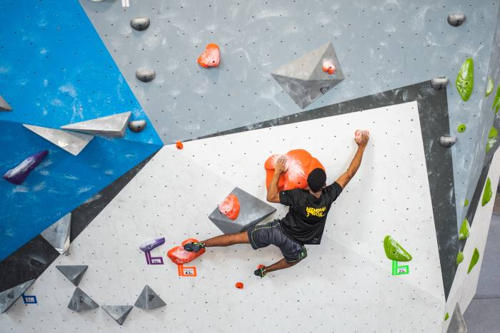 Soulsenders Climbing Team member Aden, 16, climbing in a competition at Memphis Rox