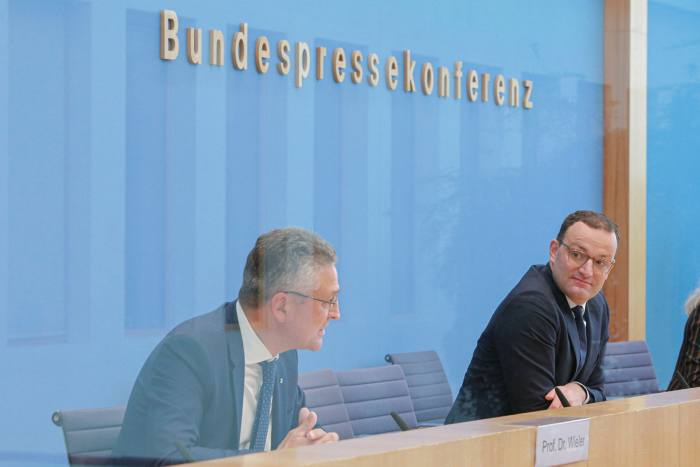 German health minister Jens Spahn, right, and Lothar Wieler, head of the country's main public health authority, warn about the rise in cases on Thursday