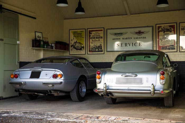 Two of Ephson's beloved classic cars, from left: a Ferrari Daytona and his 1964 Aston Martin DB5