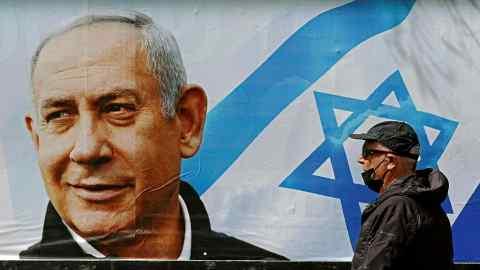 Netanyahu close to slim majority in Israel election, exit polls predict