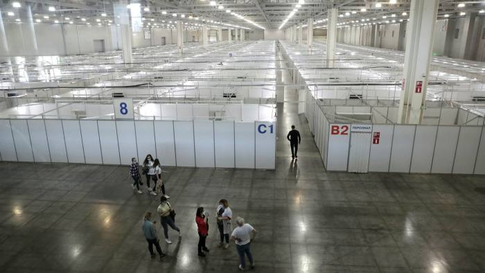 Medical personnel examinethe facilities at a temporary hospital for Covid-19 patients at the Crocus exhibition centre in Moscow on Monday
