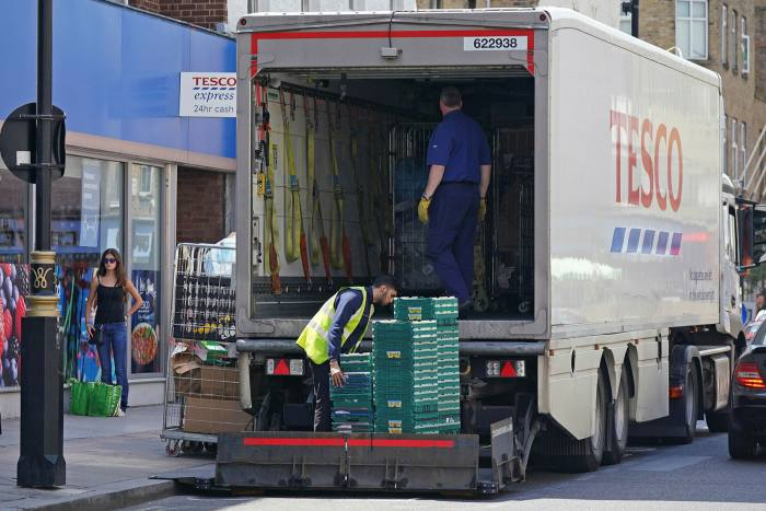 A delivery truck outside a Tesco Express store in central London