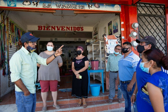Cristopher Herrera Sarmiento, 35, a vet, discusses the Maya Train with other townspeople in Escárcega, Mexico this month. Like them, his business lies in the path of the train.