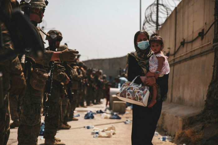 US Marines lead an evacuation at Hamid Karzai International Airport, Kabul, on Wednesday